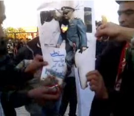 In Berkane, Morocco, pro-democracy protesters burn a photo of gendarme chief Hosni Benslimane