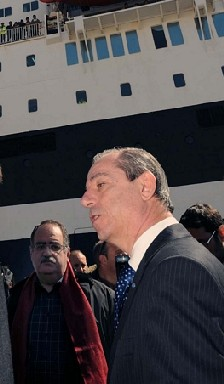 Malta's Prime Minister Lawrence Gonzi in front of a ship evacuating foreigners from Libya